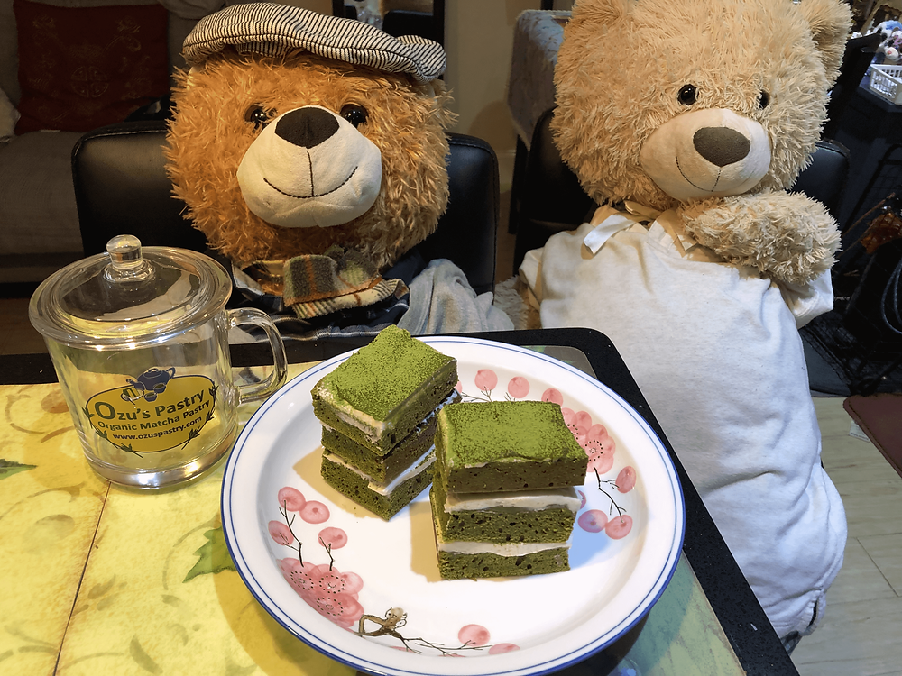 Junior and Spongy with Ozu's Organic Matcha chocolate cottage cake