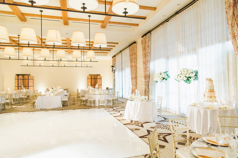 Great picture from our wedding decro set up for Valerie and Tim's wedding. OCLA Events suppliers the seamless dance floor, draping, lighting , linens, and the gold chiavari chairs.