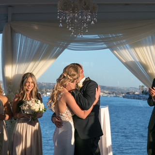 Oceanside Kiss By Bride and Groom By OCLAEvents 949-374-7258