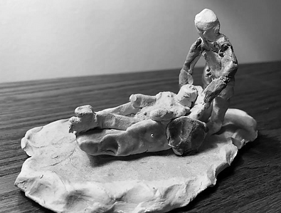 A sculpture created by Dr. Deguire's 9 year old brother of his severely injured sister