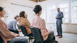 male-speaker-giving-presentation-hall-un