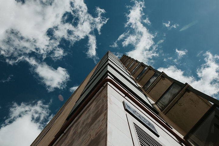 low-angle-shot-high-rise-building-clear-