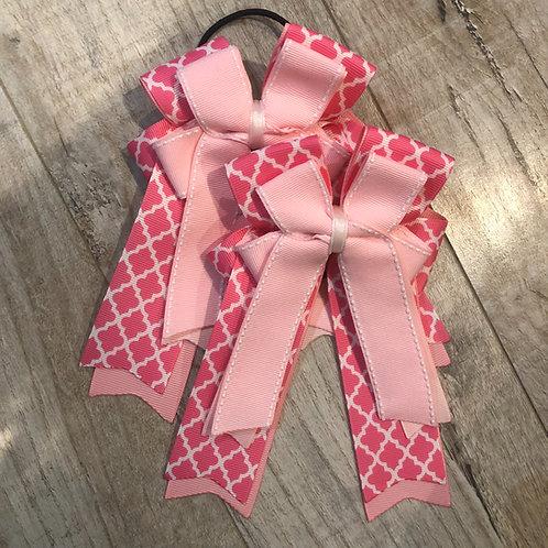 Pink stitched quatrefoil bows!