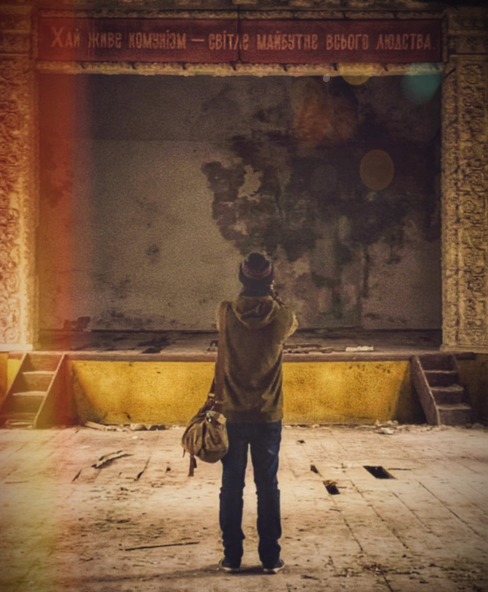 a picture of me taken from the rear in an old abandoned theatre in Chernobyl, Ukrain
