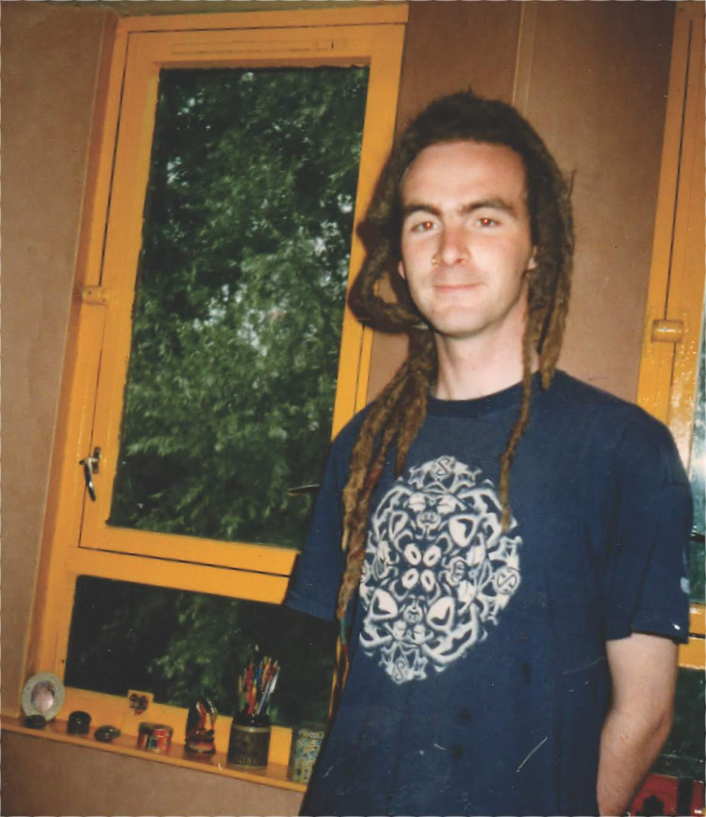 This is  a photo of me living an alternative lifestyle in Manchester, UK during the 1990's. It is a portrait of me in my early 20's complete with dreadlocks
