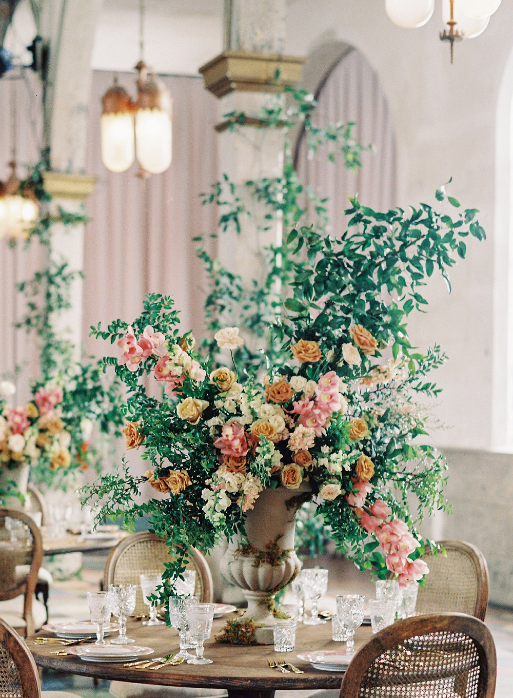 Leaf + Petal, Marigny Opera House, New Orleans, seated dinner, garden urns, smilax columns, greenery wedding, Lovegood rentals, Bridgerton wedding