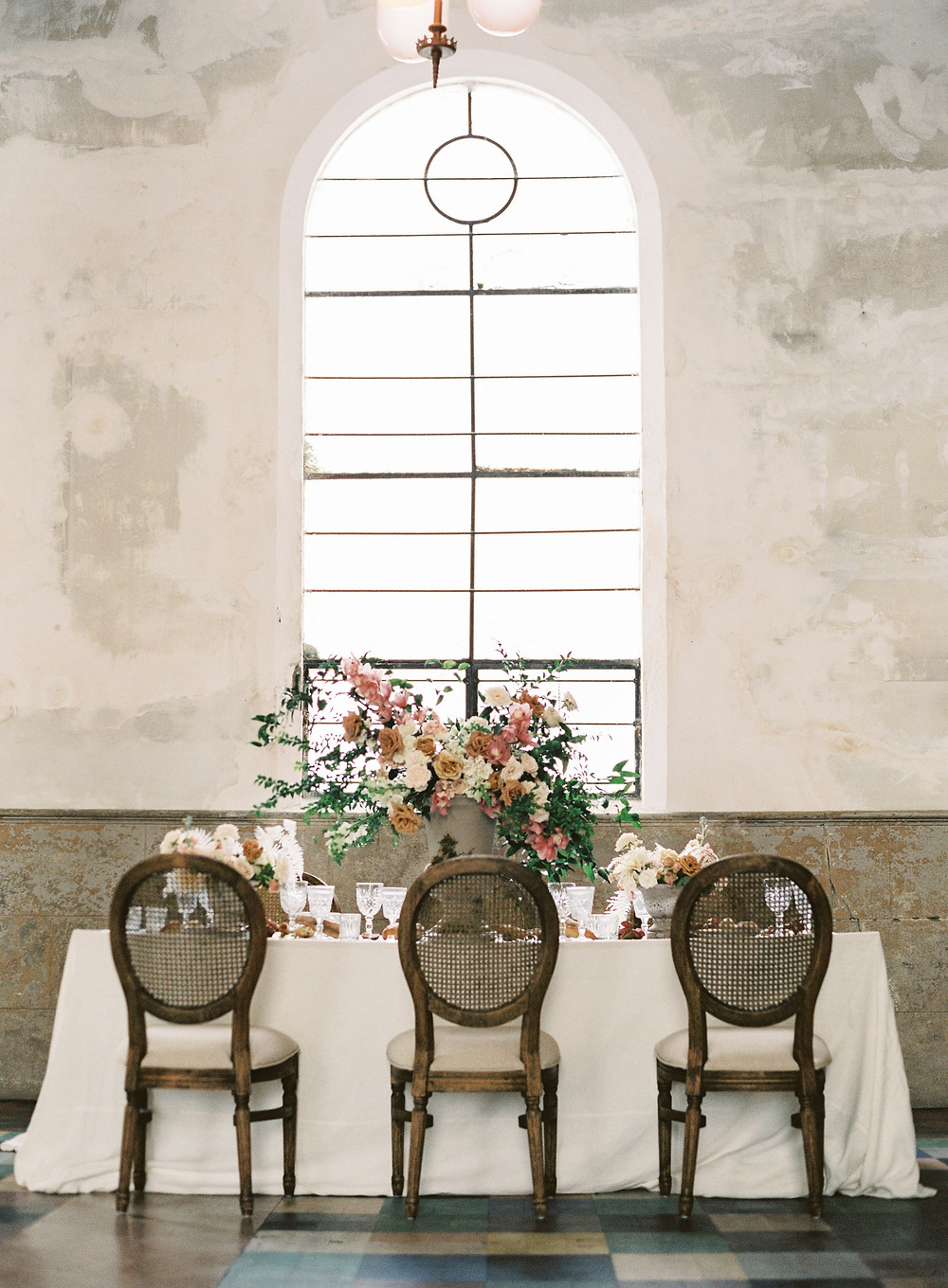 Leaf + petal, New Orleans, Marigny opera house, seated dinner, intimate wedding, cane back chairs, garden urns, Bridgerton wedding