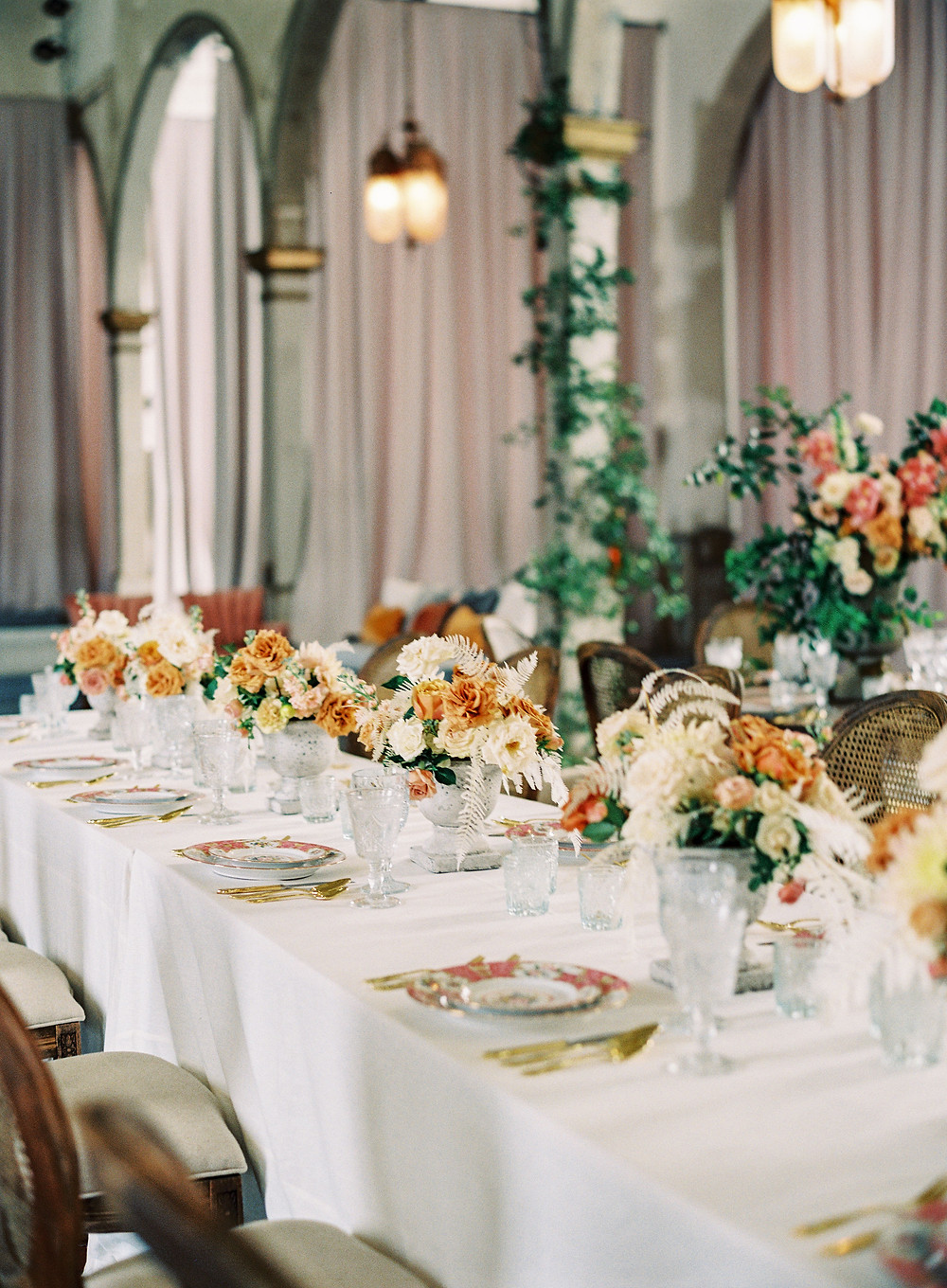 Leaf + Petal, seated dinner, Marigny opera house, smilax columns, wedding, reception, toffee roses, bleached fern, Bridgerton wedding