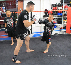 kids punching on the mitts