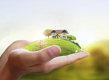 Business man house in human hands .jpg