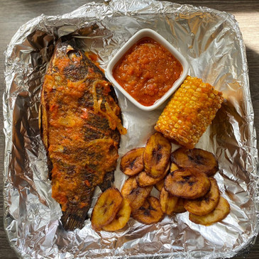 Grilled Fish with Fried Plantain, Corn on the Cob and Peppered Sauce