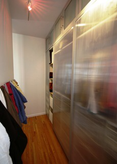 Walk-in closet behind bed