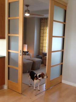 Custom pocket doors hide guestroom