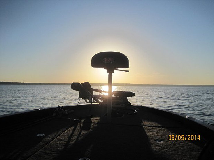Sunrise behind the butt seat of a Ranger bass boat.