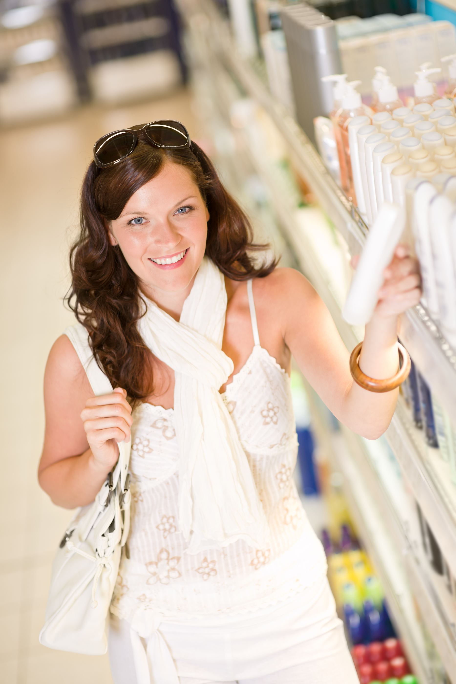 Shopping Cosmetics - Smiling Woman Choose Shampoo.jpg