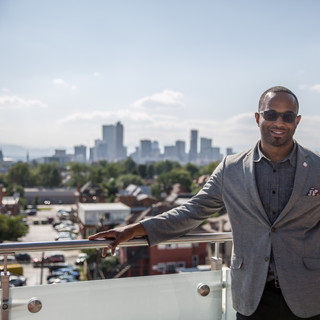 District 9 Councilman Albus Brooks and the view of Downtown Denver