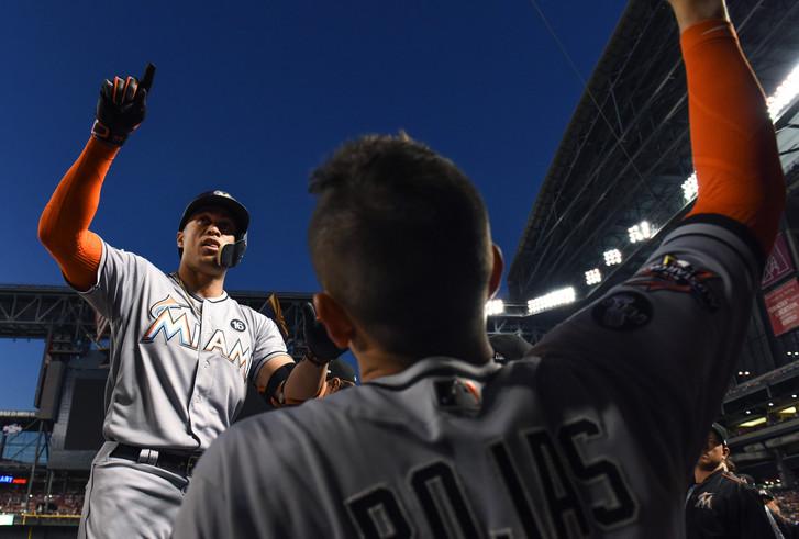 Giancarlo Stanton celebrates 57th home run