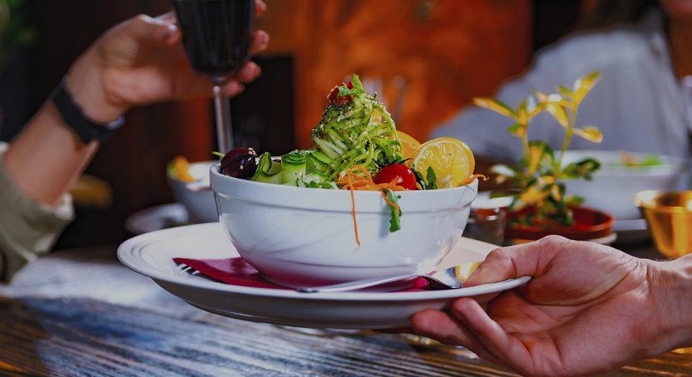 waiter-bringing-a-plate-with-vegetarian-meal-N3Y45SQ_edited_edited.jpg