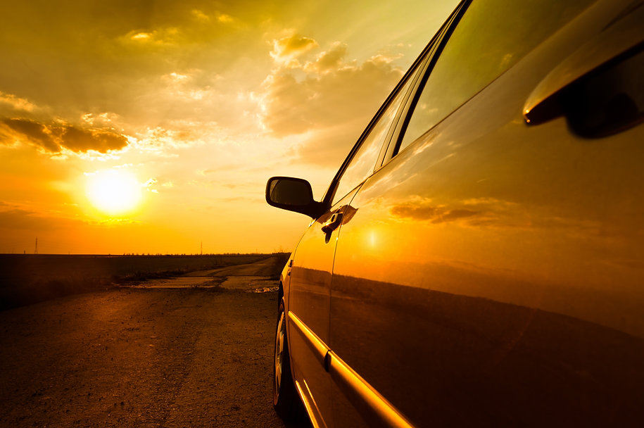 Angle shot of a car against sunset in th