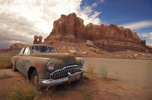 Old Car Rusting in Desert
