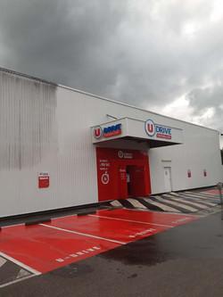 nettoyage façade hangar supermarché