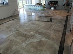 Porcelain tile floor,mahogany border goi