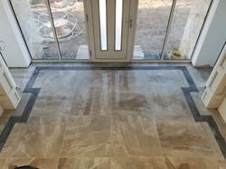 Front entrance porcelain tile floor with