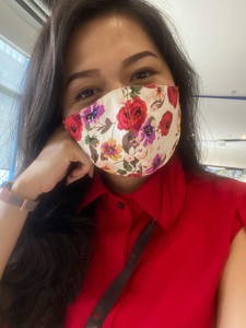 office staff with floral print mask