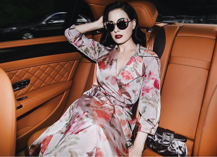 "Dita von Teese wearing ""Barbara"" raincoat"