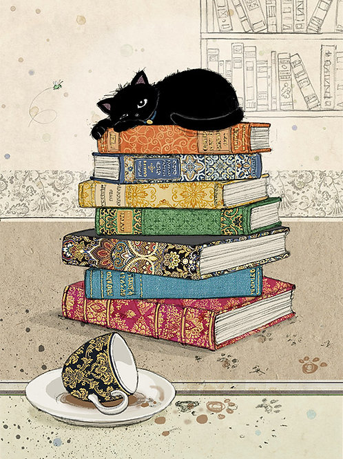 Black cat on books