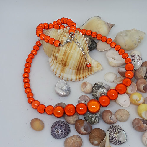 Graduated orange miracle bead necklace
