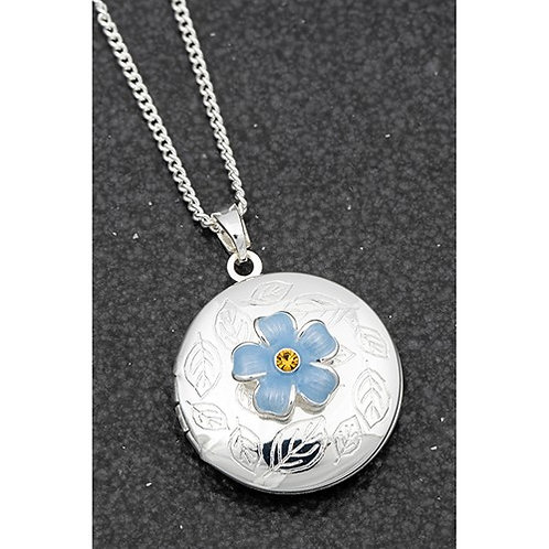 Locket with forget me not.