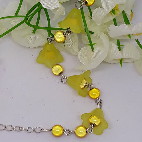 Yellow lucite flower bracelet with beads