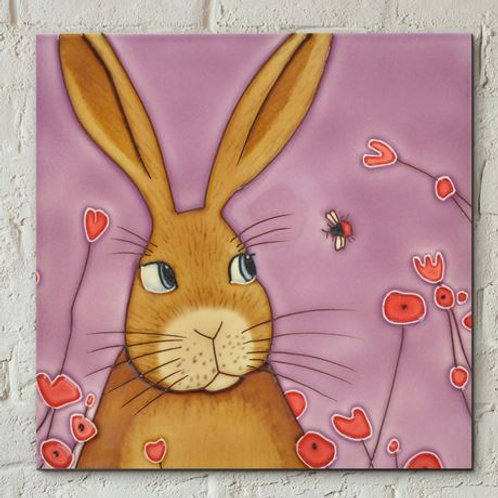 Ceramic tile, hare and red bee