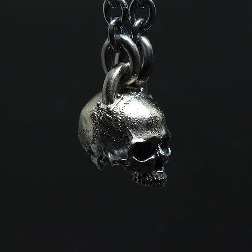 Dogma skull pendant