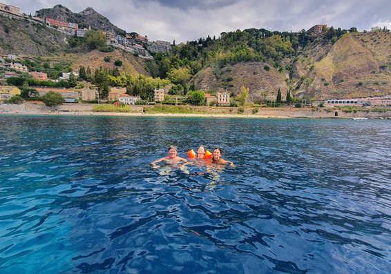 swim taormina boat