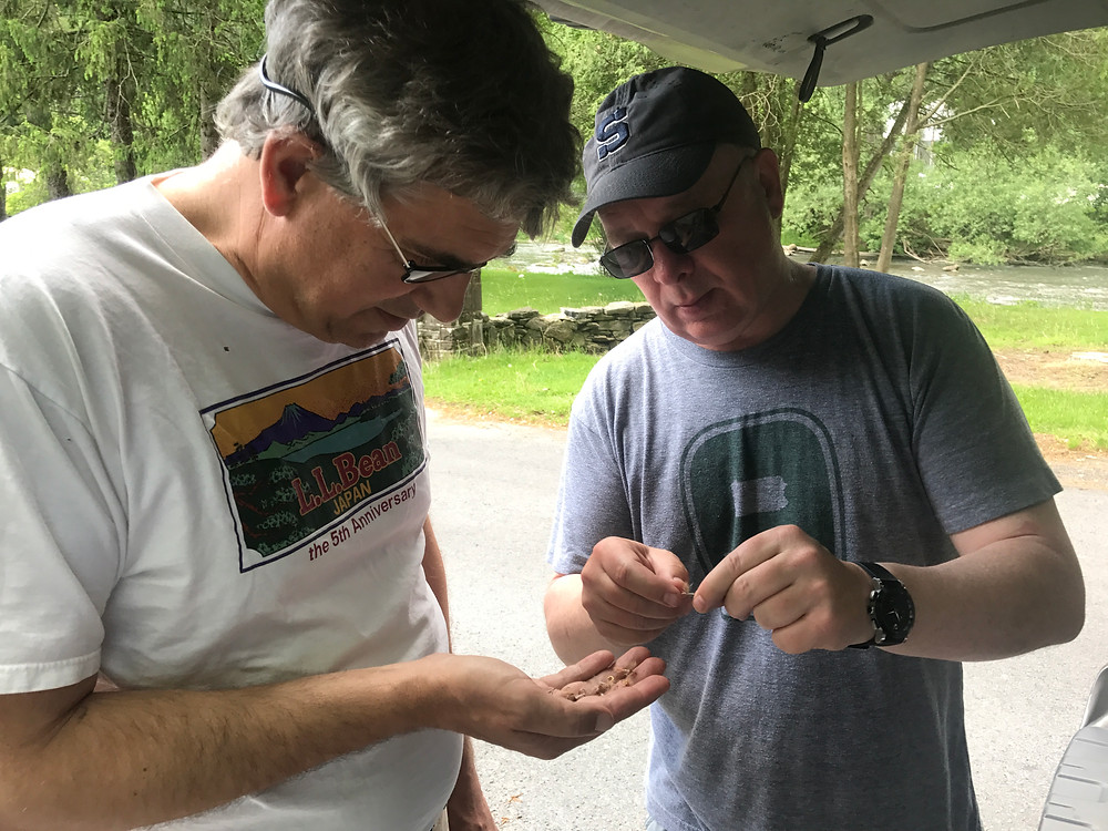 Phil Boinske shares local flies with Lou (left)