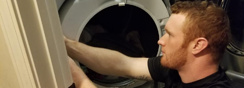 Appliance Repair Technician doing washer and dryer repair