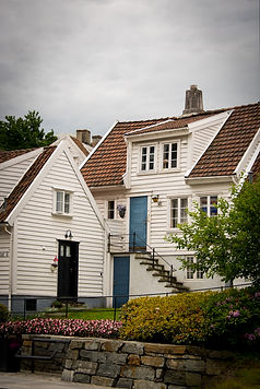 Photo of a quant Norwegian house painted white