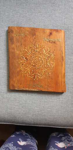 mandala on oiled wood