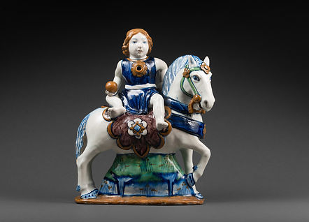 IMPORTANT AQUAMANILE REPRESENTING A RIDER SITTING SADDLE ON A RICHLY CAPARISONED HORSE Circa 1480-1500 Tin-glazed earthenware, copperta H.38 cm; W.31 cm; D.13 cm Provenance Private collection, France
