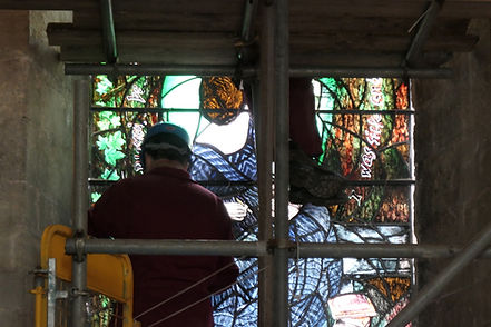 craftsmen install new stained glass window at Romsey Abbey