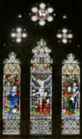 An 1870, three panel Clayton and Bell stained glass window at Romsey Abbey, entitled 'The Crucifixion' from 1870