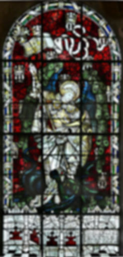 A beautiful image of the stained glass window located at Romsey Abbey, entitled 'St Michael the Archangel' and designed by Kempe.