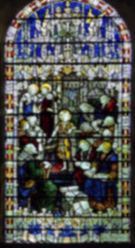 A finely detailed 1910 Kempe & Co stained glass window located in the south choir at Romsey Abbey, entitled 'Child Jesus in the Temple'.