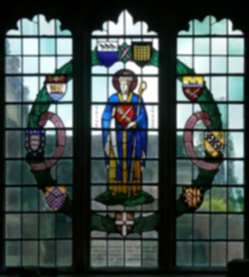 A Francis Skeat stained glass window at Romsey Abbey in memory of Revd Canon Corban.