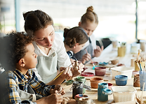 Teachers working with kids