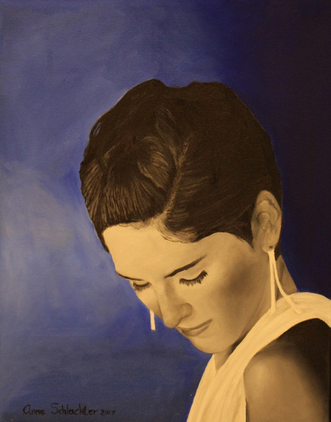 An oil painting of a self portrait. A woman looking down with her eyes closed