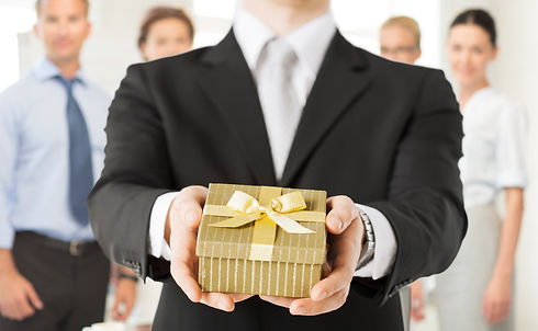 close up of man hands holding gift box i