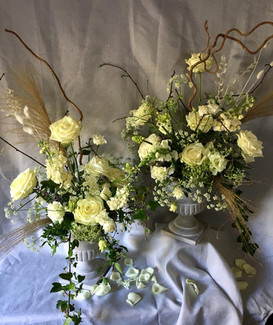 White, cream & green urns